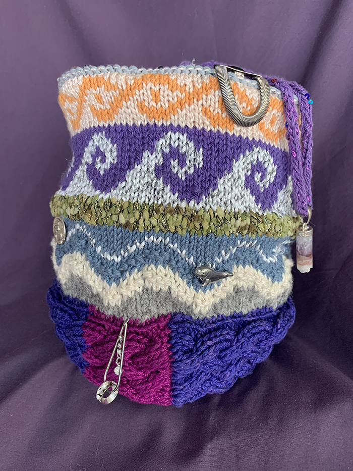 BOS Knitting 1st. Ruth Suzuki, Knitted crown w wave patterns decorated w milagros